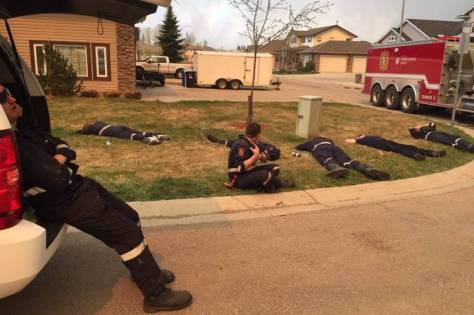 Strathcona County, Alberta firefighters take a break in Fort McMurray in this photo posted on Twitter on Thursday.