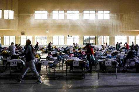 "Evacuees from the Fort McMurray wildfires use the sleeping room at the ""Bold Center"" in Lac la Biche, Alberta, on Thursday."