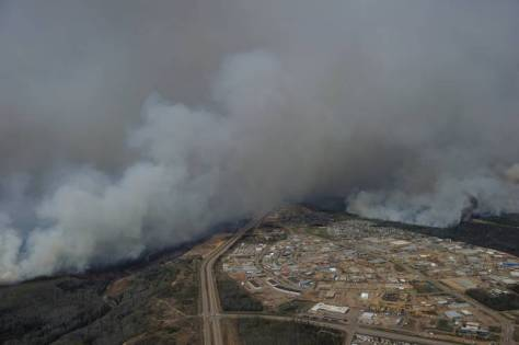 Wildfires burn near neighborhoods in Fort McMurray in this aerial photo provided by the Canadian Armed Forces.