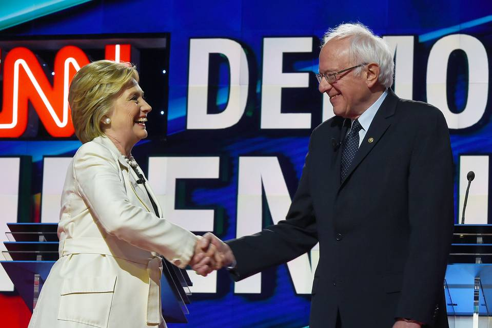 Presidential candidates Hillary Clinton, left, and Bernie Sanders shake hands before the CNN Democratic presidential debate at the Brooklyn Navy Yard on April 14, 2016, in New York.