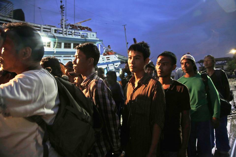 In this April 2015 file photo, Burmese fishermen prepare to board a boat during a rescue operation at the compound of a fishing company in Indonesia, where an AP investigation uncovered slavery.