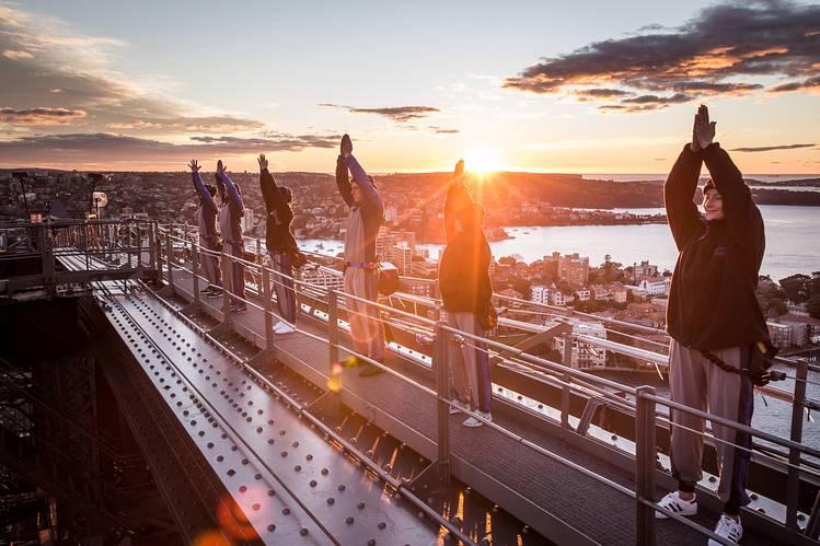 Yoga practitioners did yoga on Sydney Harbour Bridge at sunrise Tuesday.