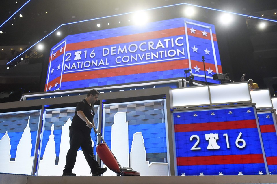 A worker vacuums the stage before the Democratic National Convention opens at the Wells Fargo Center in Philadelphia on July 25.