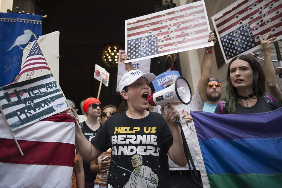 Protesters rally in support of Bernie Sanders at City Hall on Monday.