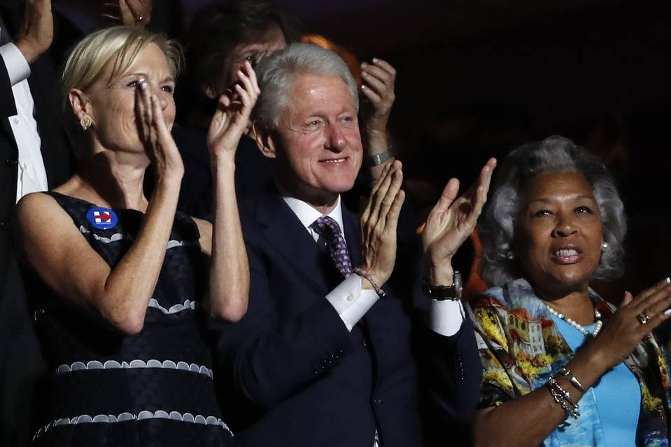 Former President Bill Clinton applauds former presidential candidate Bernie Sanders as he speaks during the first day of the Democratic National Convention.