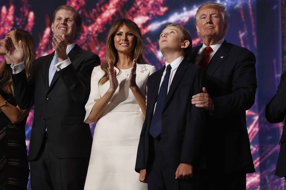 Republican presidential nominee Donald Trump stands with his son Eric, wife Melania and son Barron at the conclusion of the final session of the Republican National Convention in Cleveland.