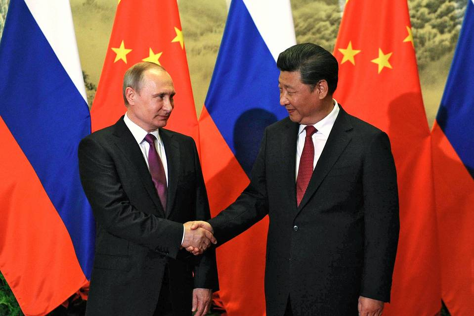 Russian President Vladimir Putin and Chinese President Xi Jinping shake hands during a meeting in Beijing in June.