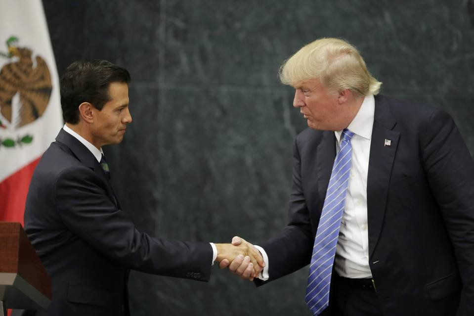 Mexican President Enrique Peña Nieto shakes hands with Donald Trump at a news conference in Mexico City on Aug. 31, 2016.