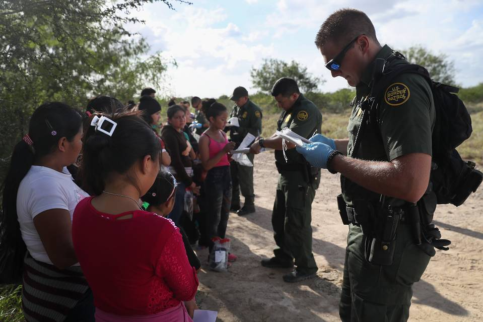 U.S. Border Patrol agents process immigrants from Central America while taking them into custody on Aug. 17, 2016 near Roma, Texas.