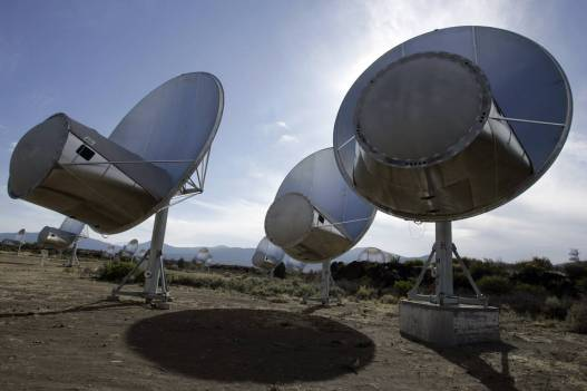 In this Oct. 9, 2007 file photo, radio telescopes of the Allen Telescope Array are seen in Hat Creek, Calif. Astronomers at the SETI Institute have been forced to shutter its program that scanned the skies for signs of extraterrestrial life, saying they're out of government funds. (AP Photo/Ben Margot, File)