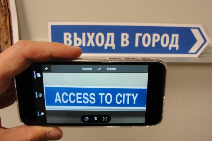An updated Google Translate app, seen in a 2015 photo, enables smartphones to translate signs, menus and more into English. Google hopes it will be useful for teachers, medical personnel, police and others in multilingual communities.