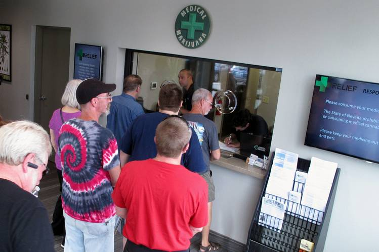 People line up to be among the first in Nevada to legally purchase medical marijuana at the Silver State Relief dispensary in Sparks, Nev.