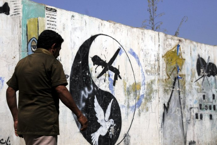 A Yemeni man walks near a painting of U.S. drone on the wall in San'a, Yemen, on Jan. 29.
