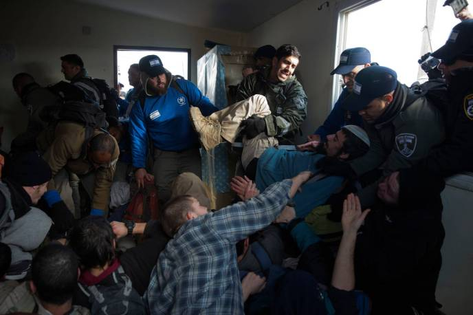 Israeli forces evacuate Jewish settlers Wednesday from Amona, an illegal West Bank settler outpost. Israeli police said that 41 police officers were injured during the evacuation, and 13 Israelis were arrested for violence.