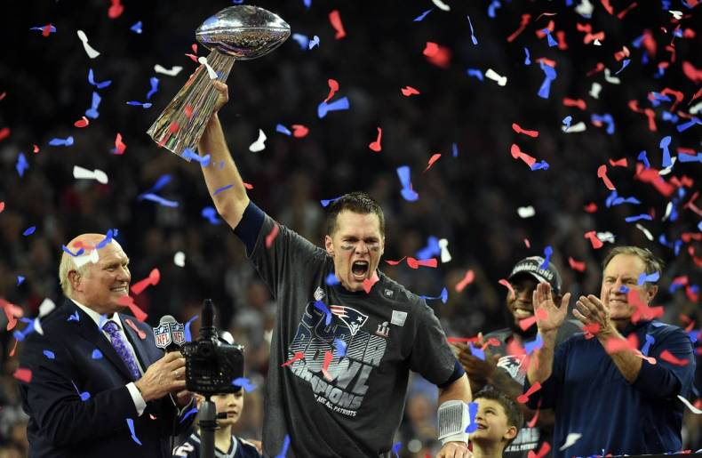 Tom Brady of the New England Patriots holds the Vince Lombardi Trophy after defeating the Atlanta Falcons 34-28 in overtime during Super Bowl 51.
