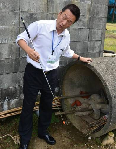 Hiroshi Sogo, 57, of Watabe, Japan, led his small village in a drill to prepare for a missile attack. Here, he points to possible hiding places.