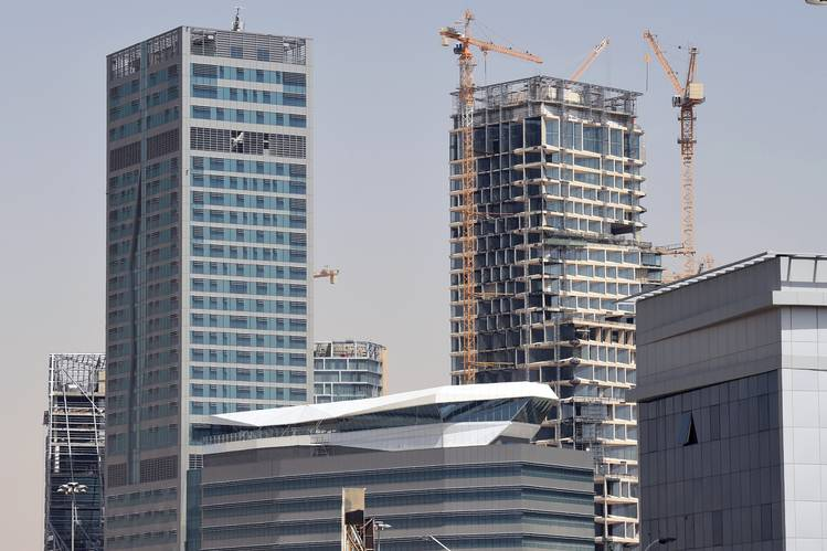 Mr. Hariri's family owns the construction company Saudi Oger, which last year was building these two towers in Riyadh. The company was buffeted by Saudi Arabia's reduction of spending on multibillion-dollar construction projects.
