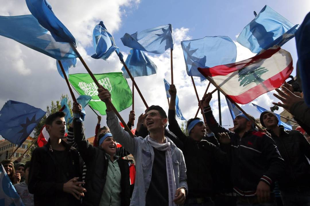 Mr. Hariri's supporters rallied outside his residence on Wednesday as one held a Saudi flag. The prime minister is a dual Saudi-Lebanese citizen who leads Lebanon's Sunni bloc.