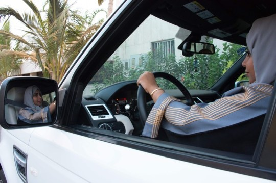 A Saudi woman takes the wheel in the Saudi coastal city of Jeddah, on Sept. 27, 2017. In June it will become legal for women to drive in the kingdom.
