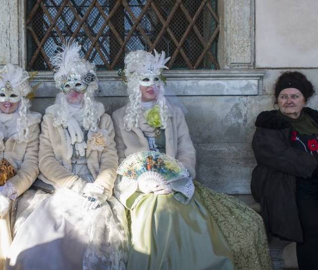 Feathered Friends Carnival Revelers In Venice