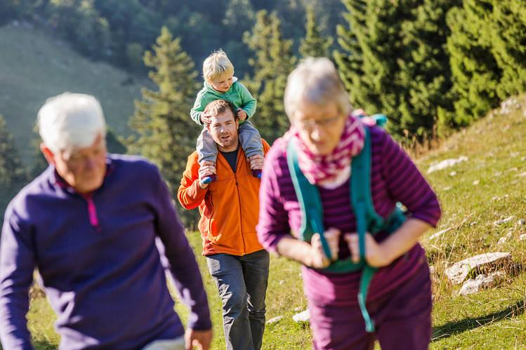 Three generations hike near Geneva, Switzerland.