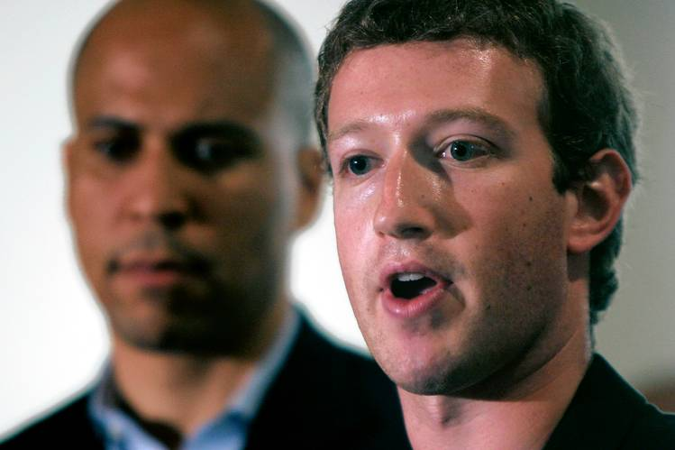 Mark Zuckerberg in 2010 with Cory Booker, mayor of Newark, N.J., at the time, discussing the Facebook CEO's $100 million donation to the city's schools.