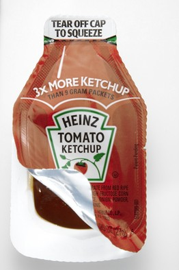 Heinz's 'Dip & Squeeze,' introduced in 2011 as a 'true packaging breakthrough.' The top portion can be torn off to apply ketchup; the bottom can be peeled back for dipping.