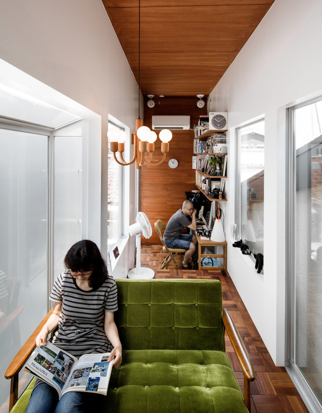 Naomi and Tomoya Sato in the main part of their two-section home designed by ON Design Partners in Tokyo.