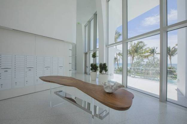 A table topped with reclaimed wood in the mailroom at Jade Signature.