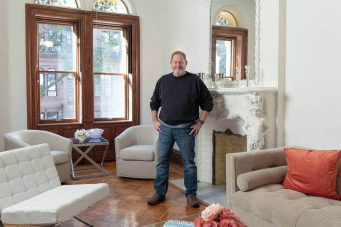 Brian Kerwin in his townhouse, which he is selling for about $5.5 million, some $3 million lower than its original listed price.