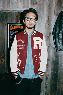 Toru Matsui, a salesperson at NYLON, one of Tsujimoto's Kobe stores, wears a varsity jacket from the label.