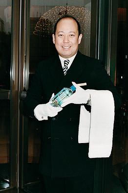 GRAND HOTEL | The Peninsula Tokyo's chief doorman Yoichiro Nagumo prepares to greet a guest back from a run.