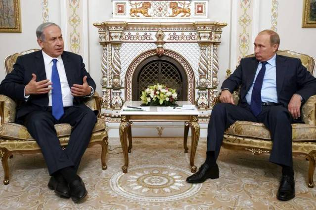 Russian President Vladimir Putin, right, met with Israeli Prime Minister Benjamin Netanyahu in Mr. Putin's home outside Moscow on Monday.