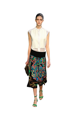 d717e24cbc2215 Simple and Sleeveless | At Hermès, a finely woven blouse is paired with a  bright skirt for spring. Evening Glamour | Carolina Herrera ...