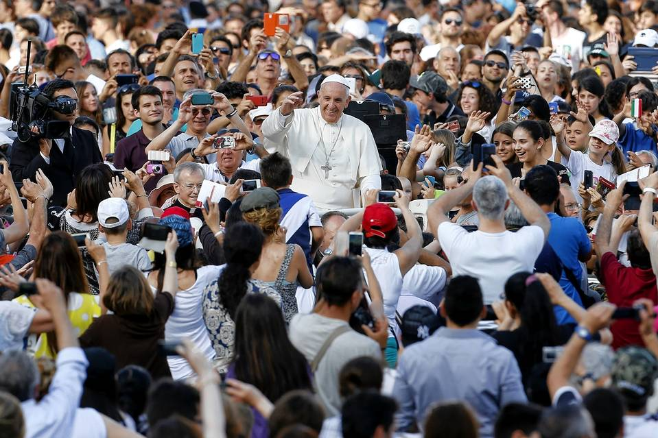 Pope Francis attended an event in St. Peter's Square at the Vatican on Sunday. In a paper, he calls for policies that reduce carbon emissions.