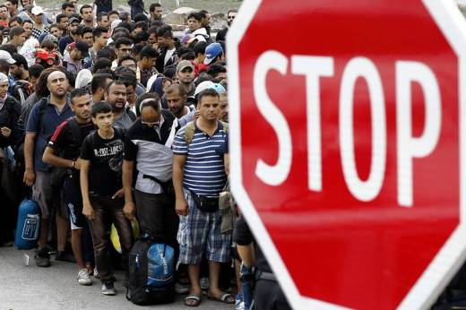 After crossing the border from Hungary, migrants in Austria waited for buses to Vienna on Tuesday.