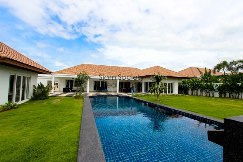 Pool, house, and gardens