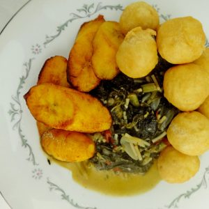 Steamed Callaloo with fried ripe plantain and fried dumplings