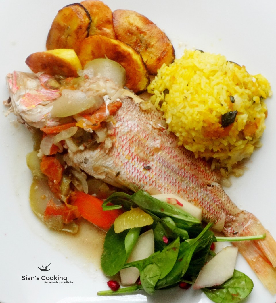 steamed red snapper with pumpkin rice, fried plantains and salad