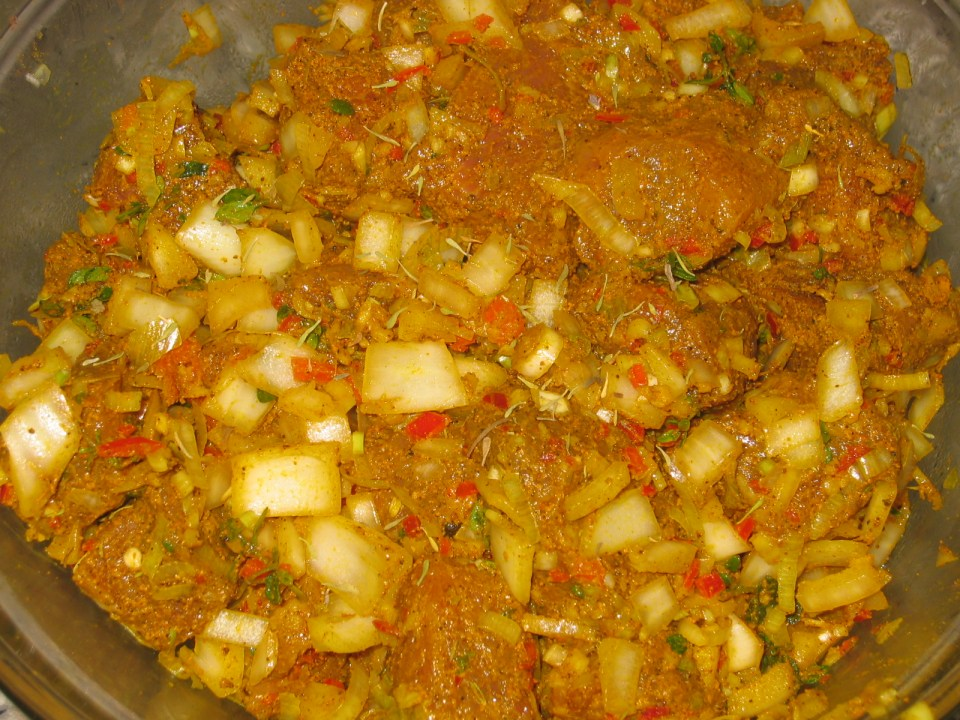 seasoned up uncooked curry goat