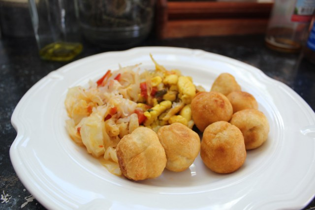 Fried dumplings served w/ Ackee & Saltfish and Steamed Cabbage.