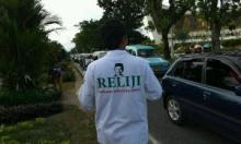 Relawan Indonesia Jokowi di Padang Turun ke Jalan Bagikan Takjil