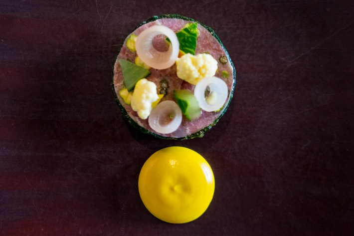 Ham hock and pistachio terrine with piccalilli. Photo by Simon Wilder