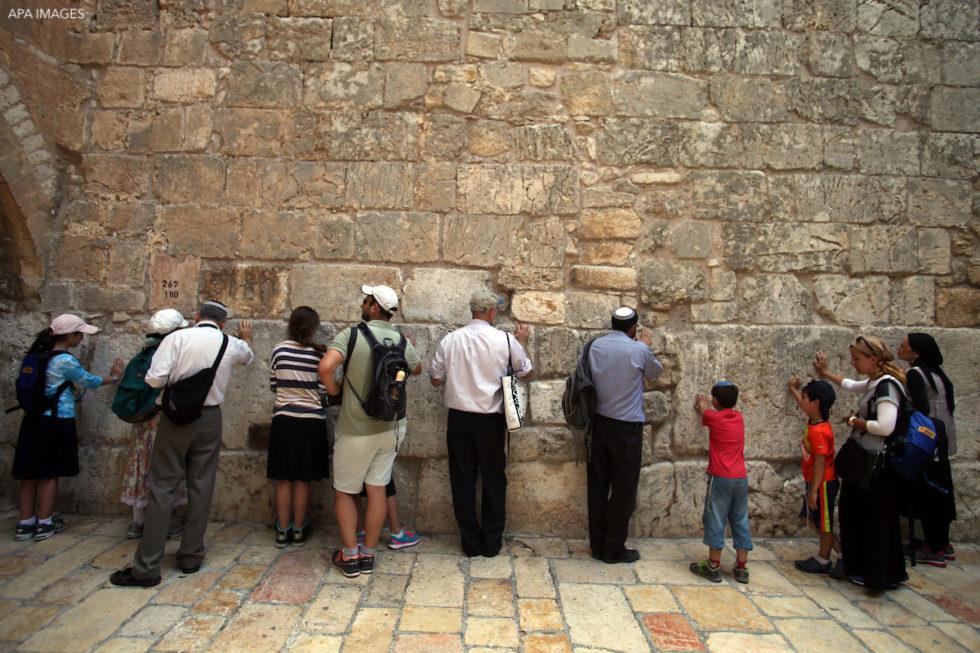 Israeli ultra-Orthodox Jews pray at the Iron Gate Known as (Bab al-Hadid?)