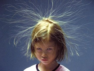little girl with flyaway static in hair