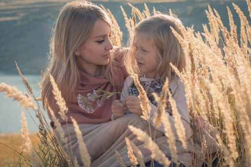mom and daughter in field