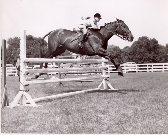 George, in 1950, shows off his amazing form over fences.  Carl Klein Photo courtesy of The Chronicle of the Horse