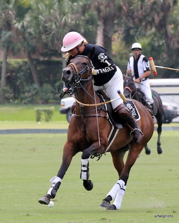 Melissa Ganzi wears her trademark pink polo helmet when competing. Photo by Alan Fabricant