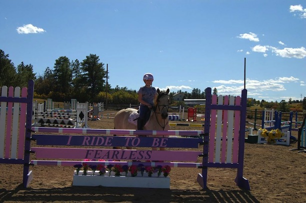 """The """"I Ride To Be Fearless"""" jump was built as a surprise for Avery by donations from her barn family. Avery loved Taylor Swift and Taylor's song Fearless. The """"I Ride To Be Fearless"""" phrase became the inspiration in honor of Avery's fight. Photo by Rochelle Costanza"""