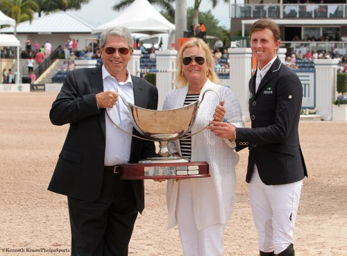 Jane Clark was presented with the 2014 Harrison Cup Perpetual for the performance of her horses Cella, Urico and Aristo Z at the Winter Equestrian Festival under the ride of Ben Maher. Left to right: Hunter Harrison, Jane Clark and Ben Maher. Photo by Kenneth Kraus.